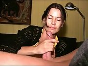 Magnificent brunette cougar jerks cock to orgasm